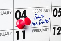 February 04. Wall calendar with a red pin - February 04 stock images