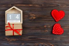 14 February. wood calendar with red heart and gift box on top Valentine`s Day card. Copy space royalty free stock image