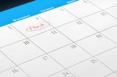 Fecha debida del alquiler en la paginación del calendario Imagen de archivo