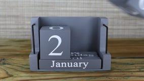 fecha 20 en el calendario de madera del cubo por los meses de enero metrajes