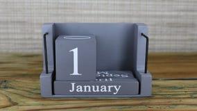 fecha 19 en el calendario de madera del cubo por los meses de enero metrajes