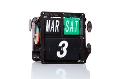 Fecha retra del calendario mecánico aislada Foto de archivo