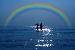 Fecha secreta bajo el arco iris Foto de archivo