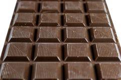 Fechado acima da barra de chocolate escura mouthwatering com foco seletivo fotografia de stock