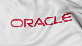 Feche acima da bandeira de ondulação com logotipo de Oracle Corporation, rendição 3D ilustração stock