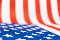 Feche acima da bandeira de papel dos EUA, foco seletivo em uma estrela Foto de Stock