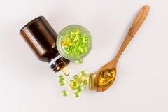 Feche acima da cápsula do óleo da prímula de noite, alimento suplementar Fotos de Stock Royalty Free