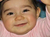Feche acima da cara do bebê com primeiros dentes Foto de Stock Royalty Free