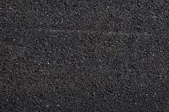 Feche acima da estrada asfaltada, fundo preto do asfalto da natureza, textura do fundo do asfalto áspero Imagens de Stock