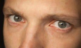 Feche acima da foto dos olhos do homem Imagem de Stock