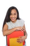Feche acima da jovem mulher feliz que inclina-se em seus livros fotografia de stock