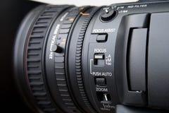 Feche acima da lente de câmara de vídeo profissional Fotos de Stock Royalty Free