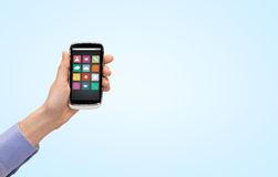 Feche acima da mão com ícones do menu do smartphone Imagens de Stock Royalty Free