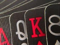 Feche acima da mão de cartões de jogo Imagens de Stock