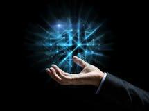 Feche acima da mão do homem de negócios com holograma Fotos de Stock Royalty Free