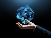 Feche acima da mão do homem de negócios com holograma Imagem de Stock