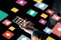 Feche acima da mão do homem de negócios com smartphone de vidro Imagens de Stock Royalty Free