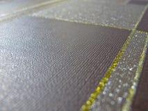 Feche acima da matéria têxtil marrom do squre foto de stock royalty free