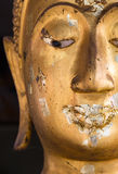 Feche acima da meia cara de um buddha Imagens de Stock