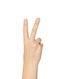Feche acima da mão que mostra o sinal da paz ou da vitória Fotos de Stock Royalty Free