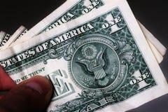 Feche acima da moeda do Estados Unidos da América imagem de stock