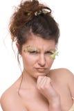 Feche acima da mulher nova com pena compo Imagem de Stock