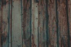 Feche acima da parede feita de pranchas de madeira fotografia de stock royalty free
