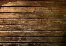 Feche acima da parede marrom feita de pranchas de madeira Imagem de Stock Royalty Free