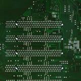 Feche acima da placa de circuito do computador no verde Imagens de Stock