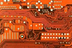 Feche acima da placa de circuito vermelha do computador Foto de Stock Royalty Free