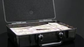 Feche acima da rotação da caixa completamente de um milhão de dólares imagens de stock royalty free