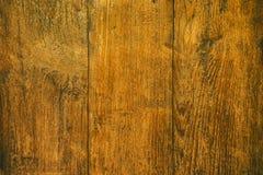 Feche acima da tabela de madeira rústica com textura da grão no estilo do vintage Foto de Stock
