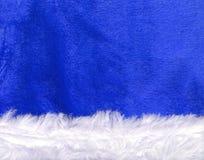 Feche acima da textura azul do chapéu de Papai Noel Imagens de Stock Royalty Free