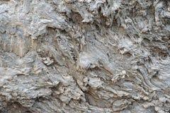 Feche acima da textura cinzenta do fundo da cara da rocha da lava Foto de Stock Royalty Free
