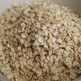 Feche acima da textura da farinha de aveia Alimento saudável Fotos de Stock Royalty Free