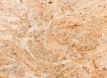Feche acima da textura da placa orientada da costa (OSB) Imagem de Stock