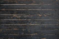 Feche acima da textura de madeira velha preta da parede Imagens de Stock Royalty Free