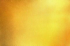 Feche acima da textura moderna dourada para o fundo do feriado do encanto Fotografia de Stock Royalty Free
