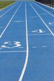 Feche acima da trilha azul da escola Imagem de Stock Royalty Free