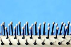 Feche acima da vista de uma escova de cabelo Imagem de Stock