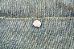Feche acima das calças de brim com botão Imagens de Stock