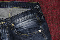 Feche acima das calças de brim da forma, foco selecionado Fotos de Stock