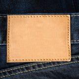 Feche acima das calças de brim de couro marrons vazias Imagens de Stock