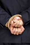 Feche acima das mãos amarradas do homem de negócios imagens de stock