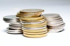 Feche acima das moedas no fundo branco Foto de Stock Royalty Free