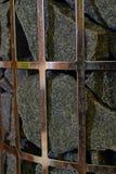 Feche acima das pedras no calefator da sauna do coluna-modelo Foto de Stock Royalty Free