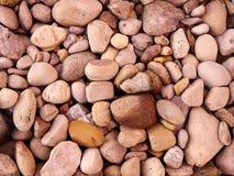 Feche acima das rochas na terra Foto de Stock