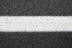 Feche acima de Asphalt With White Line Fotografia de Stock Royalty Free