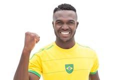 Feche acima de cheering brasileiro do fan de futebol Imagem de Stock