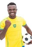 Feche acima de cheering brasileiro do fan de futebol Fotos de Stock Royalty Free
